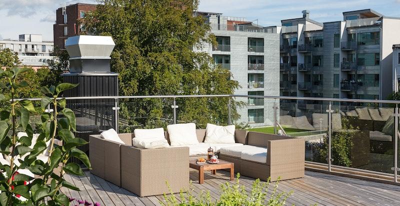 Felles takterrase med flott utsikt og gode solforhold