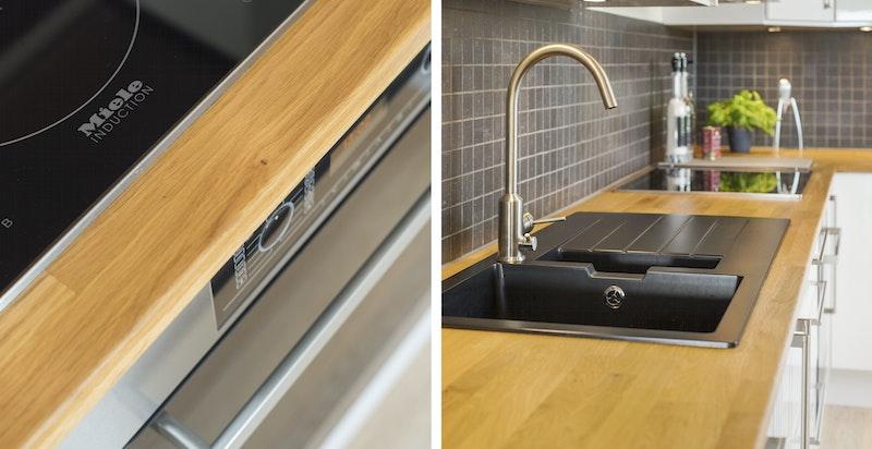 Eik heltre benkeplate med nedfelt vask og skyllekum. Integrert Miele induksjon platetopp og stekeovn, integrert oppvaskmaskin fra Asko og integrert kjøl/frys.