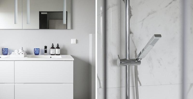 Badet er nyoppusset og inneholder vegghengt WC, dobbelservant og dusjhjørne