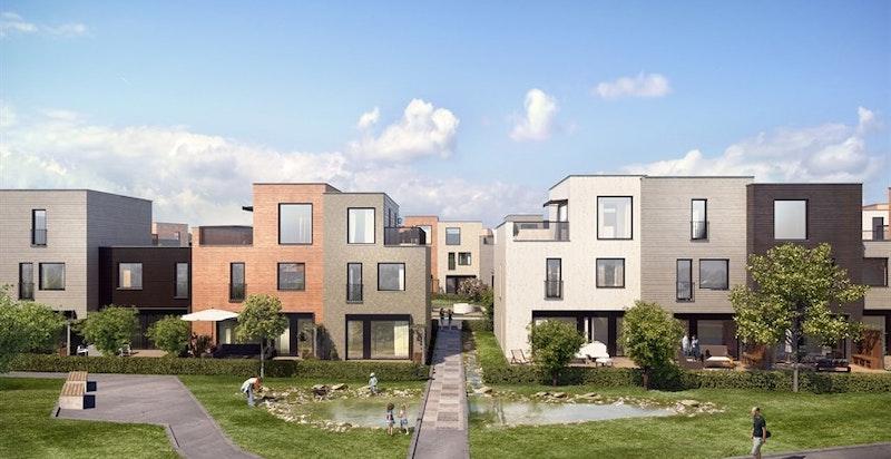 Fasade husrekke J. Boligen er et enderekkehus som vender mot hyggelig friområde/grøntområde.