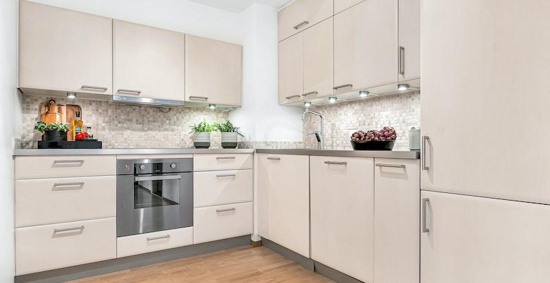 Kjøkken i åpen løsning mot stuen