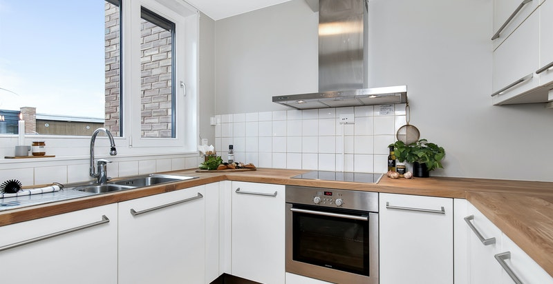Separat kjøkken med innredning fra Poliform.