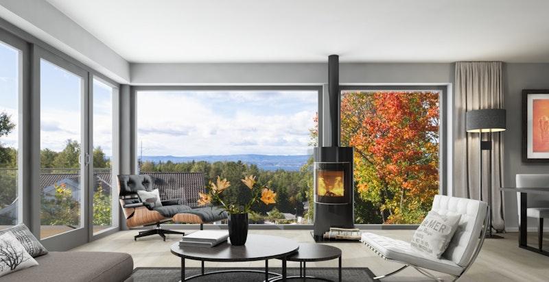 Stue med store vindusflater og ildsted - Bildet er kun illustrasjon