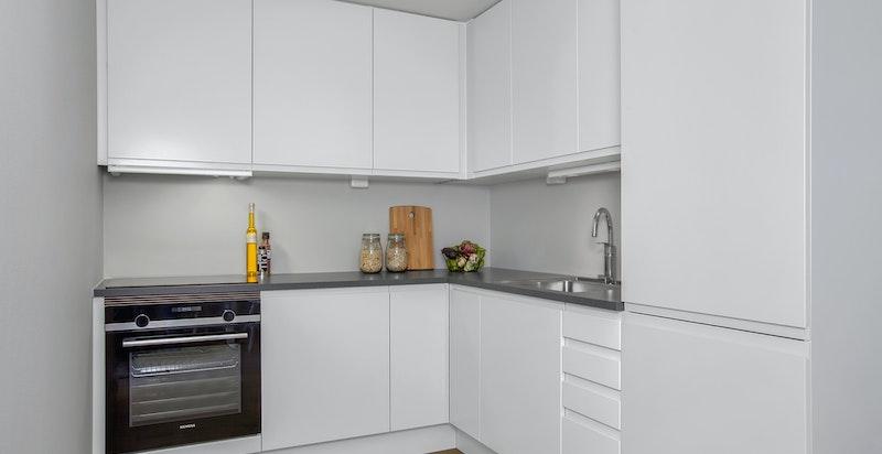 Lekkert kjøkken fra Sigdal med integrerte hvitevarer fra Siemens
