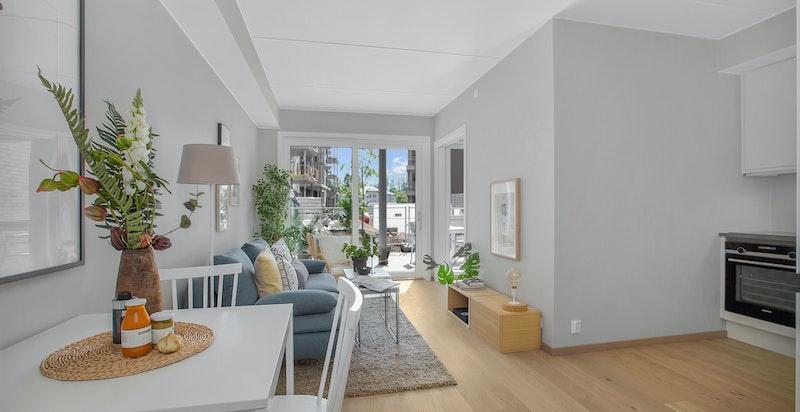 Åpen løsning mellom stue og kjøkken