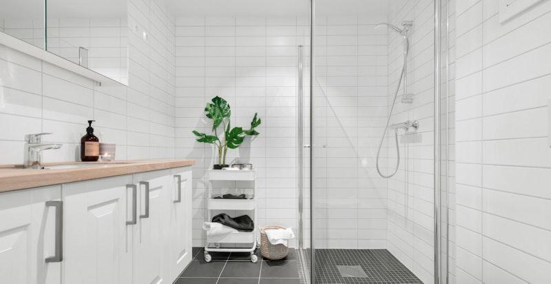 Opplegg for vaskemaskin og tørketrommel på begge badene