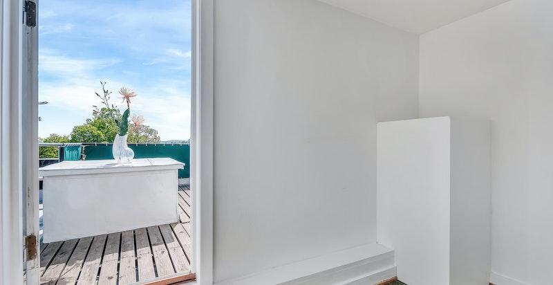 Loftsetasjen/trapperom med utgang til den flotte takterrassen