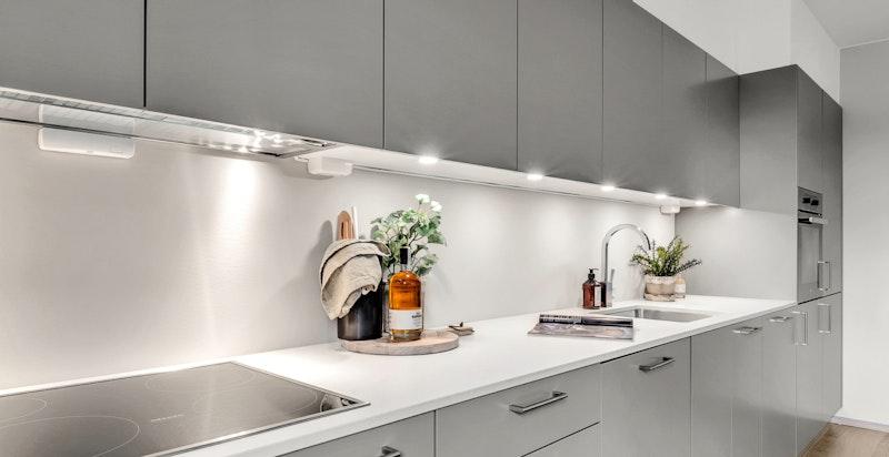 Lekkert kjøkken fra kvalitetsleverandøren Kvänum med integrerte hvitevarer.