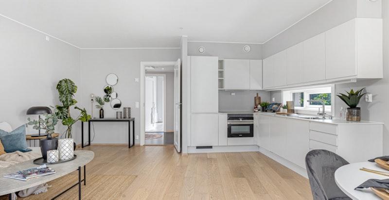 Moderne og stilrent kjøkken fra Sigdal i modellen Horisont med hvite og glatte fronter.