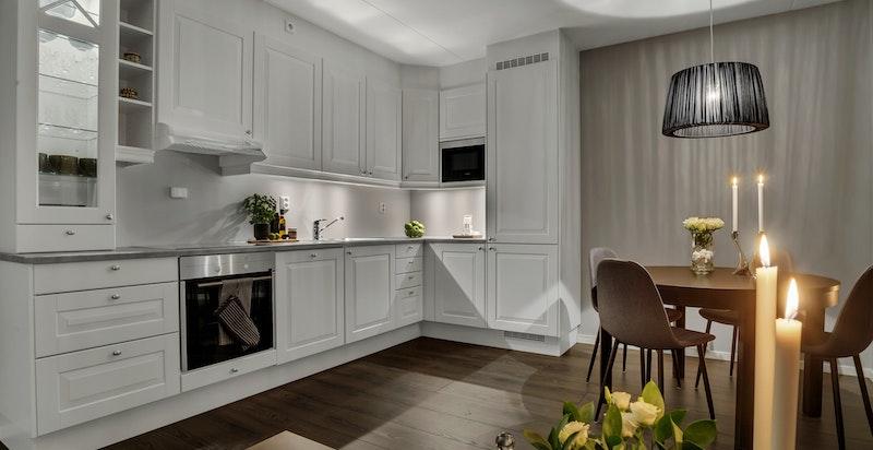 Åpen stue/kjøkken løsning. Kjøkkeninnredning fra Sigdal.