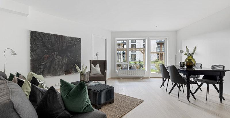 Stue med plass for sofagruppe og spisebord.