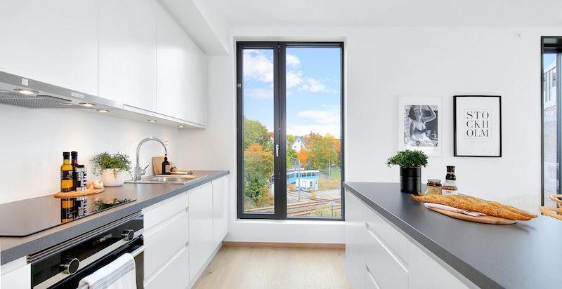 Sigdal Horisont kjøkkeninnredning og integrerte hvitevarer fra Siemens