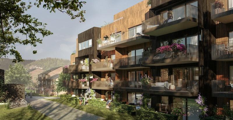 Bygg D ligger solrikt og fredlig, helt inn mot en liten skogkledd kolle.