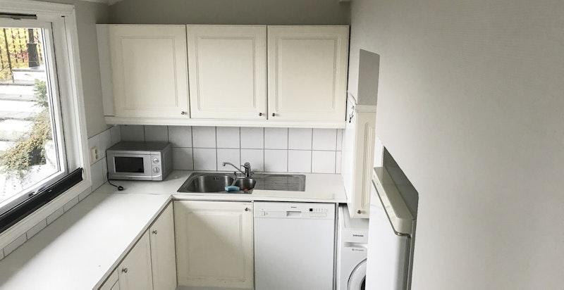 Kjøkken med opplegg vaskemaskin