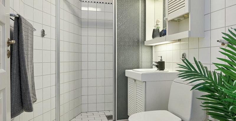 Flislagt bad med elektriske varmekabler i gulv.