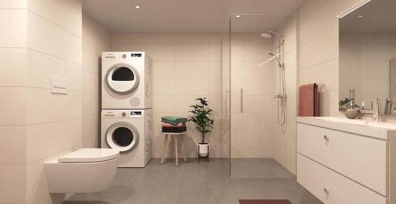 Stort bad/vaskerom i boligens underetasje. Tidsriktige, delikate fliser og moderne innredning.