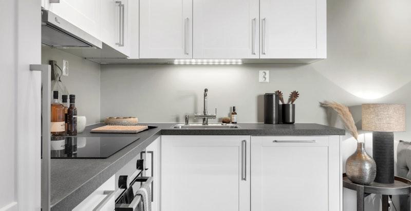 Moderne Sigdal kjøkken med integrerte hvitevarer fra Siemens.
