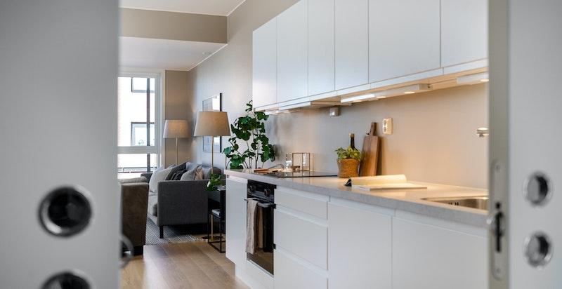 Kjøkkenet er godt utstyrt med integrerte hvitevarer