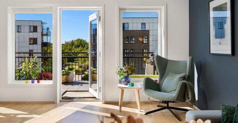 Stue med utgang til balkong. Her kan man sette opp et soverom 3 om ønskelig.