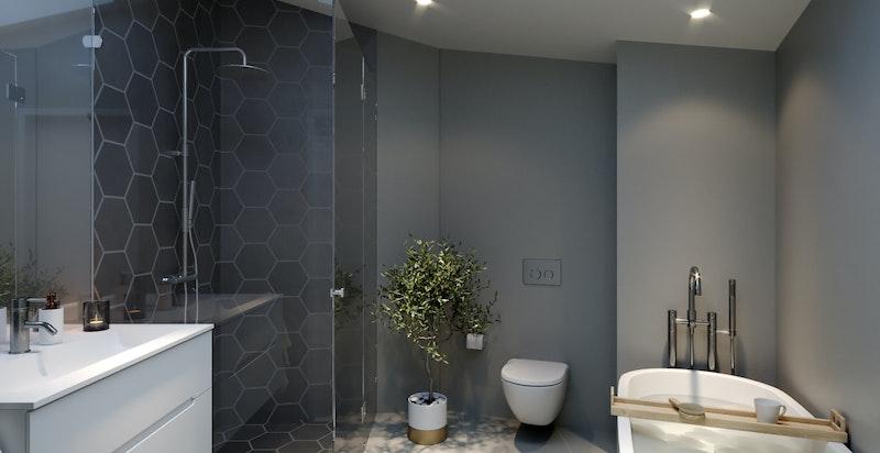 Baderommet i stallen har svært kvalitetsbevisste og stilsikre materialvalg med både badekar og dusj.