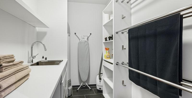 Praktisk vaskerom med ny innredning fra Kvik