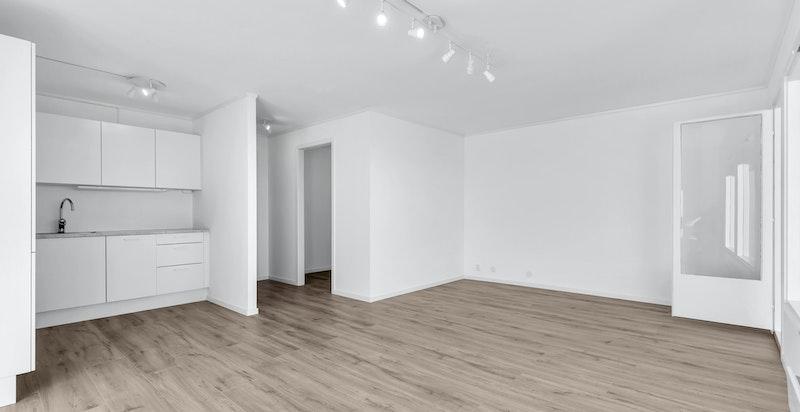 Åpen stue/kjøkken-løsning. Leiligheten har en arealeffektiv planløsning.