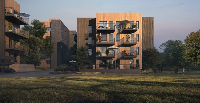 Åkergløden ligger i naturskjønne omgivelser. Fasader er tilpasset med trepanel i jordfarger.