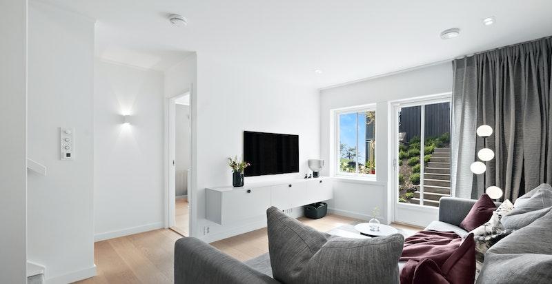 Kjellerstuen ligger i tilknytning til to soverom. I en tenkt alternativ planløsning kan man sette inn vegg/dør og benytte kjellerstuen som soverom 4
