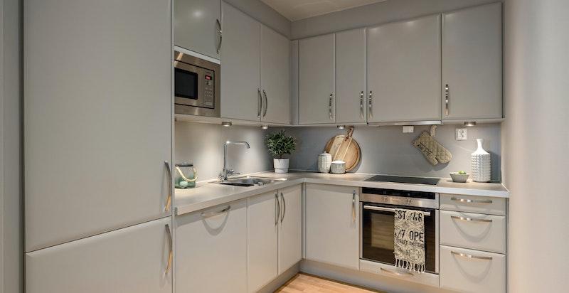 Kjøkkenet ligger i delvis åpen løsning mot stuen