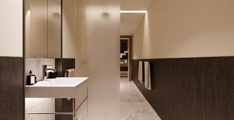 Gjestebadet ligger praktisk og usjenert til mellom omkledningsrommet og tv-stue/arbeidsrom med adkomst fra trappehall.