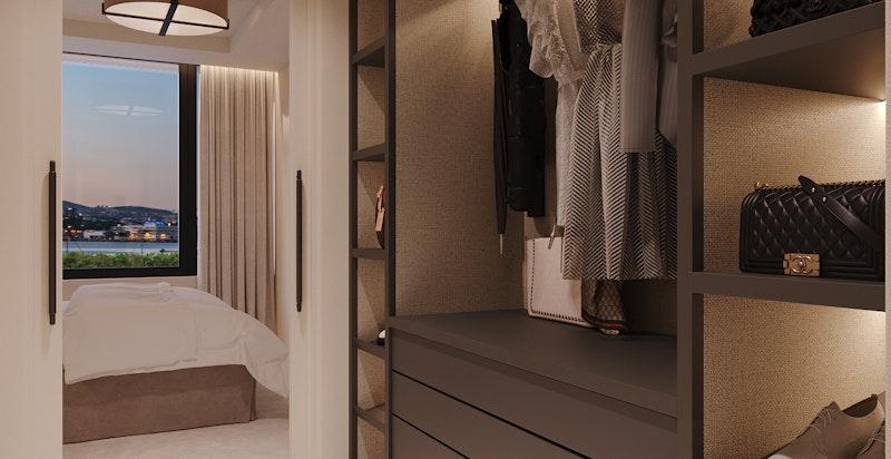 """Poliform Senzafine """"walk through"""" garderobe på master bedroom."""