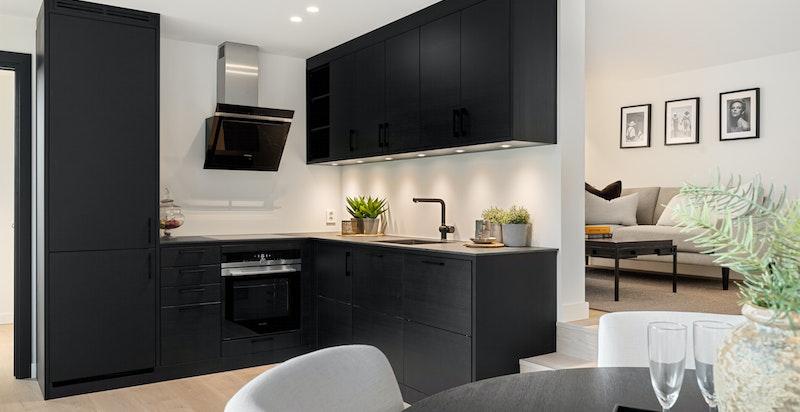 Kjøkken (ikke målbart/godkjent areal på baksiden, innredet som stue)