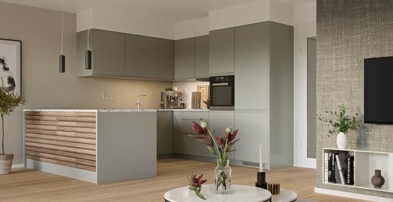Leiligheten får en gjennomgående god standard med vannbåren gulvvarme (illustrasjon av kjøkken til annen leilighet i prosjektet).