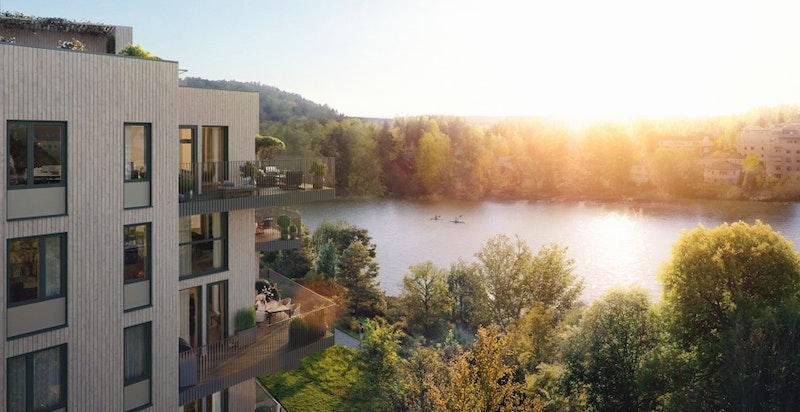 Prosjektet ligger idyllisk til med gode solforhold og nærhet til vannet (illustrasjon av bygg A i prosjektet).