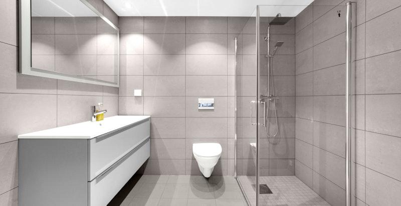Delikat flislagt hovedbad med lekre grå fliser og moderne innredning.